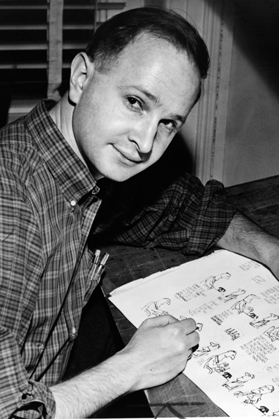 Picture of Jules Feiffer. Jules Feiffer in 1958 with proof sheets from his first book, Sick Sick Sick (McGraw-Hill, 1958). Library of Congress. New York World-Telegram & Sun Collection.
